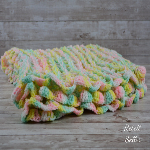 A colorful cotton candy colored afghan for nursery decor or to bundle your little one up.