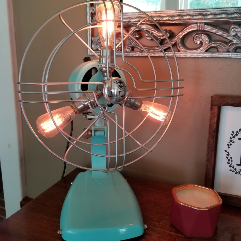 An old metal fan completely refurbished into the perfect aqua blue lamp.