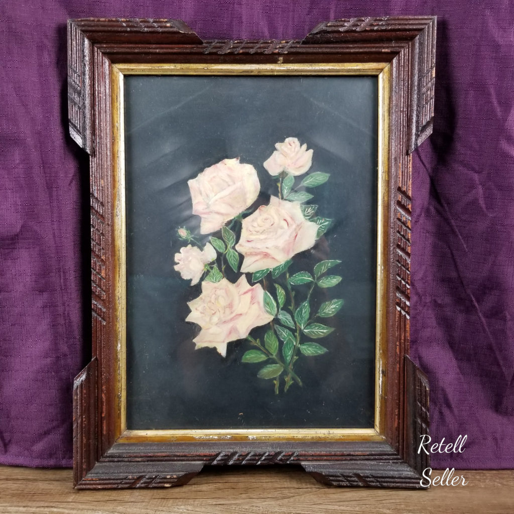 An amateur vintage or maybe even antique painting of multiple roses. The wooden frame is just as gorgeous.
