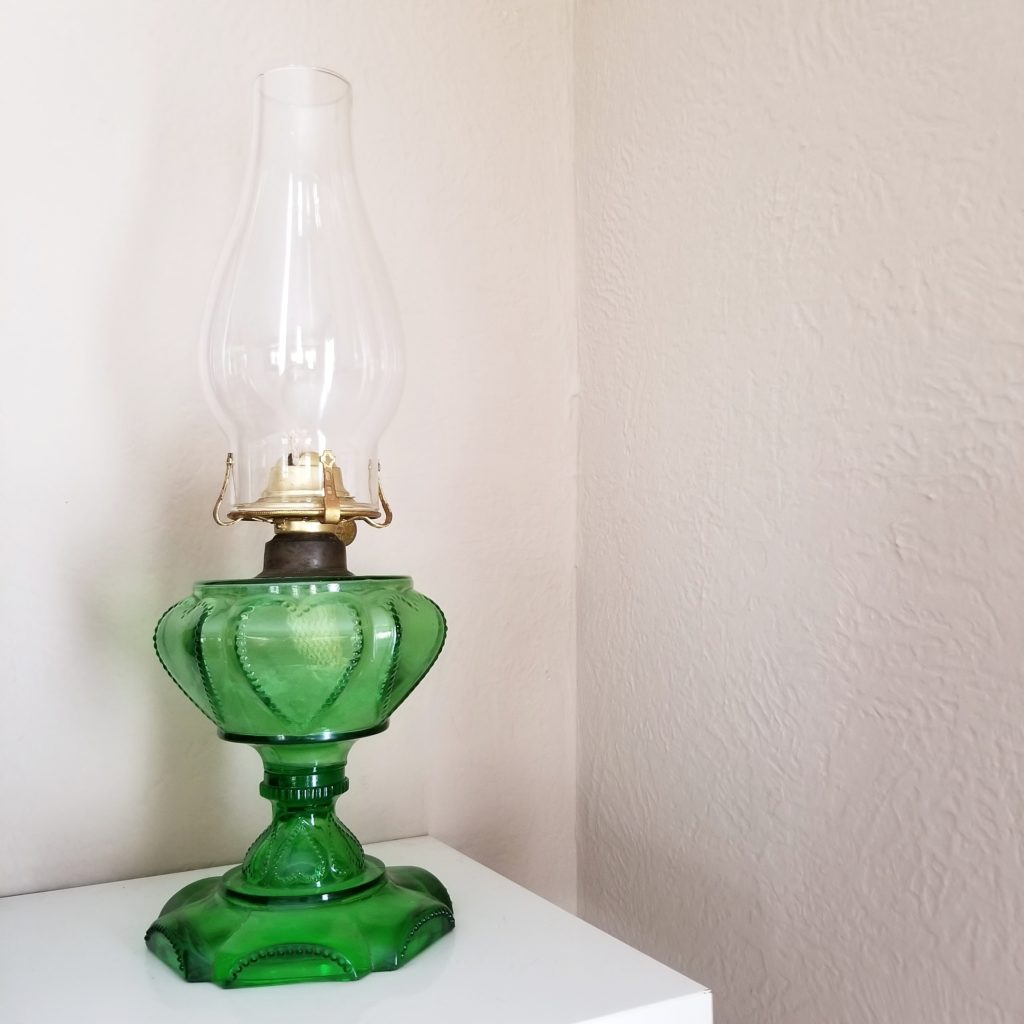 I found this green oil lamp at an auction and realized once I got home, it was broken. It's still cute though.