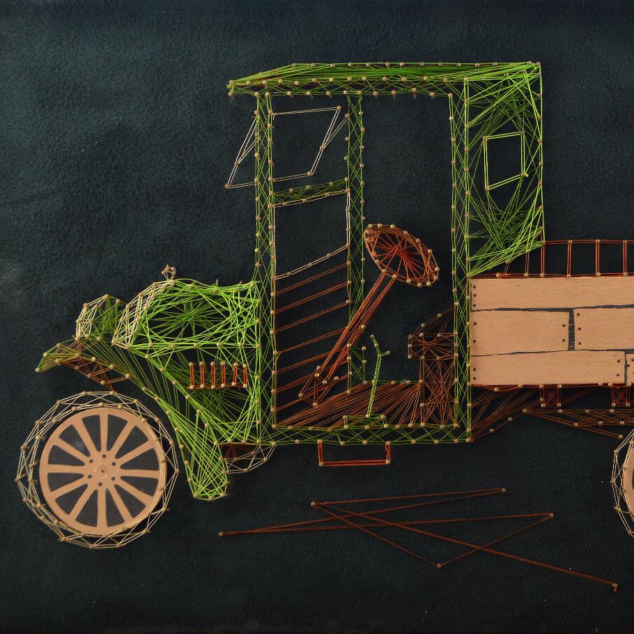 Vintage string art depicting an antique car.