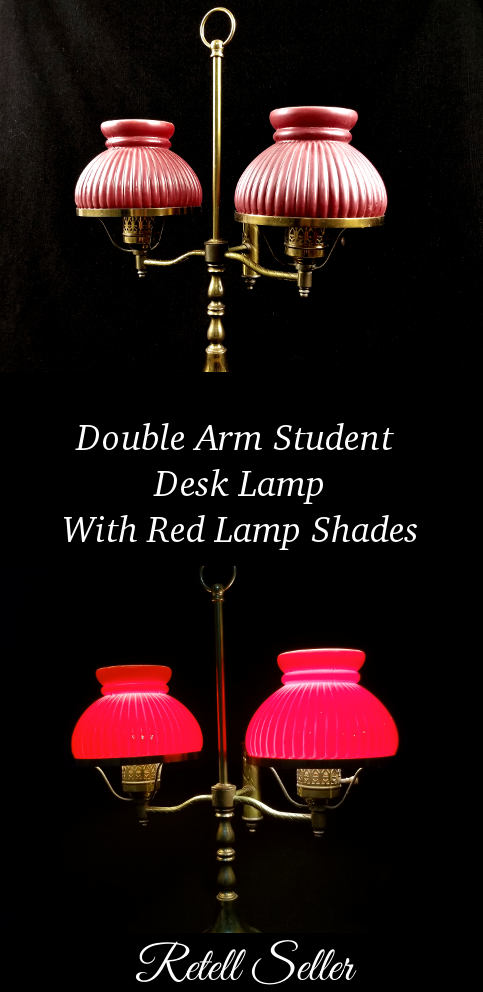 A beautiful double arm lamp with red shades adding some mood to your boudoir