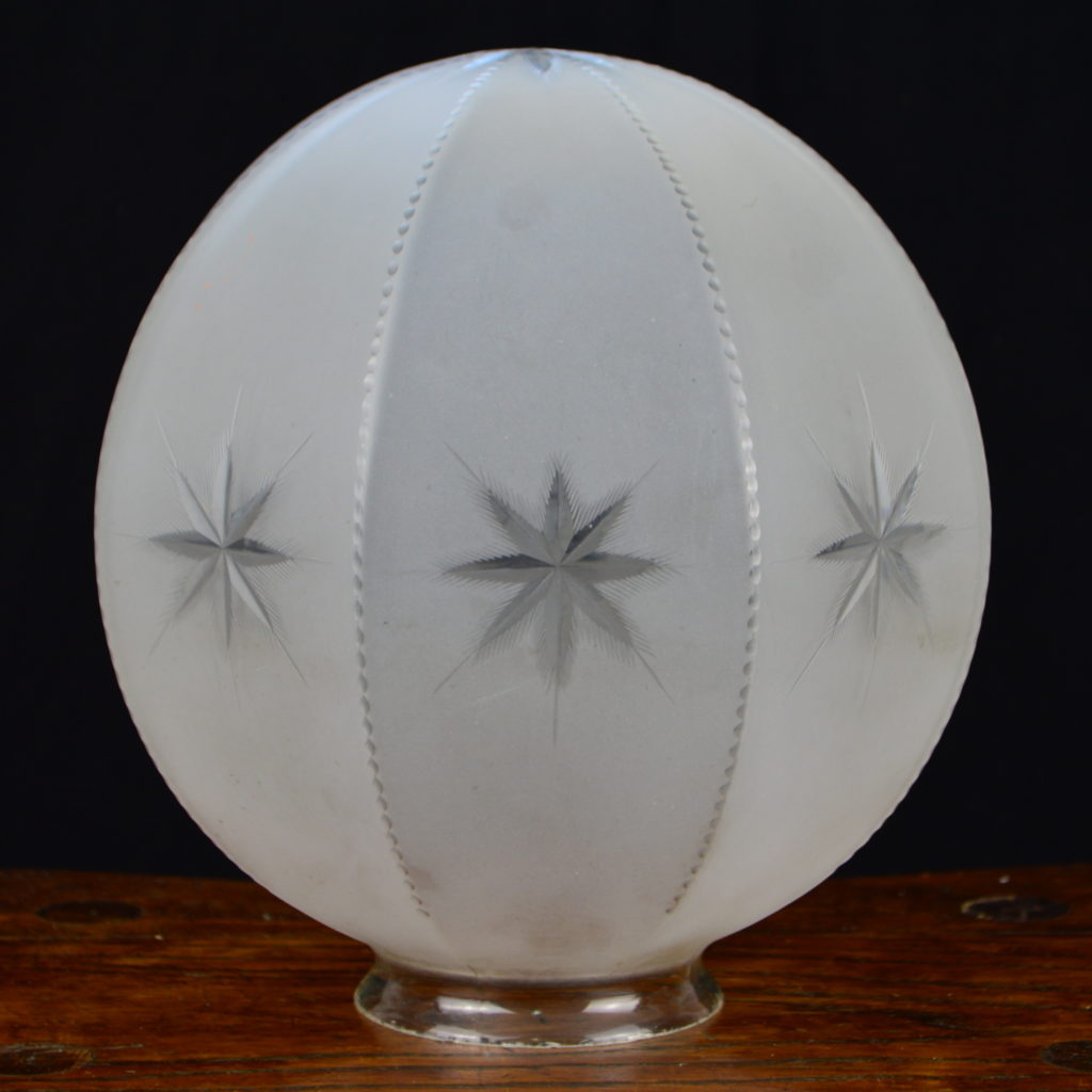 8 sided frosted glass ceiling fixture globe with starburst designs on each panel and on the part that shines down on a room. - Retell Seller