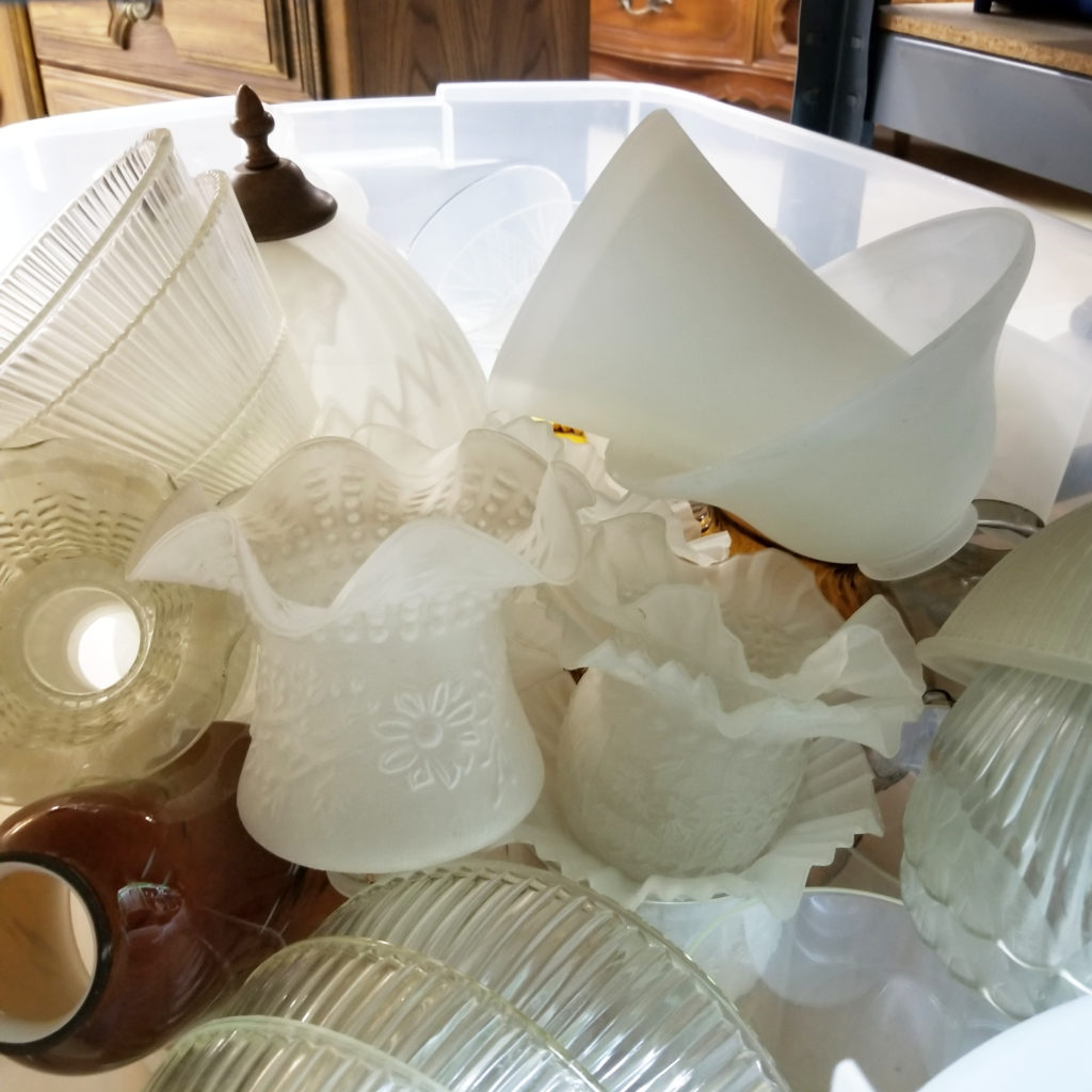 Fragile glass lamp shades stuffed in a tote. - Retell Seller